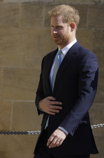 Britain's Prince Harry arrives to attend the Easter Mattins Service at St. George's Chapel, at Windsor Castle in England Sunday, April 21, 2019. (AP Photo/Kirsty Wigglesworth, pool)