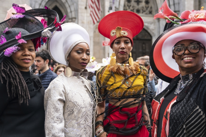 Participants wearing costumes and hats poses for a photo during the Easter Parade and Bonnet Festival, Sunday, April 21, 2019 in New York. (AP Photo/Jeenah Moon)