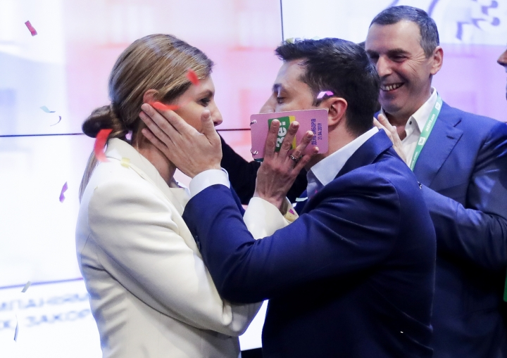 Ukrainian comedian and presidential candidate Volodymyr Zelenskiy, and his wife Olena Zelenska congratulate each other at his headquarters after the second round of presidential elections in Kiev, Ukraine, Sunday, April 21, 2019. Ukrainians voted on Sunday in a presidential runoff as the nation's incumbent leader struggles to fend off a strong challenge by a comedian who denounces corruption and plays the role of president in a TV sitcom. (AP Photo/Sergei Grits)