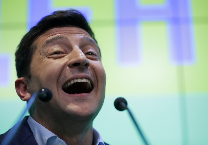 Ukrainian comedian and presidential candidate Volodymyr Zelenskiy speaks to the media and his supporters at his headquarters after the second round of presidential elections in Kiev, Ukraine, Sunday, April 21, 2019. A comedian whose only political experience consists of playing a president on TV appeared poised to reprise the role in real life when an exit poll showed him winning Ukraine's presidential runoff Sunday in a landslide. (AP Photo/Sergei Grits)