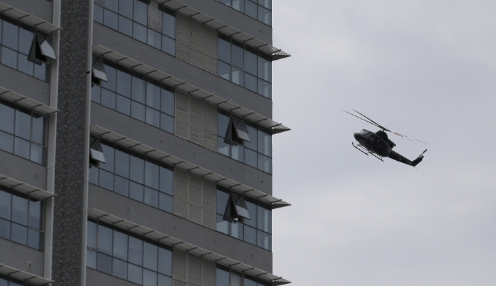 A Sri Lankan airforce helicopter flies over a house suspected to be a hideout of militants following a shoot out in Colombo, Sri Lanka, Sunday, April 21, 2019. More than two hundred people were killed and hundreds more injured in eight blasts that rocked churches and hotels in and just outside Sri Lanka's capital on Easter Sunday. (AP Photo/Eranga Jayawardena)