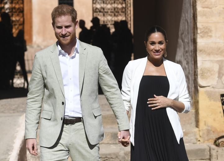 FILE - In this Monday, Feb. 25, 2019 file photo, Britain's Prince Harry and Meghan, Duchess of Sussex visit the Andalusian Gardens in Rabat, Morocco, Monday, Feb. 25, 2019. The time is drawing near for the impending royal birth of the first child for Prince Harry and his wife Meghan, the Duchess of Sussex. The couple is keeping many details about Meghan's pregnancy and birth plan private and say they don't know the baby's gender yet. (Facundo Arrizabalaga/Pool Photo via AP, File)