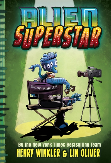 "This cover image released by Abrams shows ""Alien Superstar,"" by Henry Winkler and Lin Oliver. Winkler is planning an out-of-this-world take on fame and show business. The 73-year-old actor known for ""Happy Days"" and ""Barry"" has a three-book deal with Abrams Children's Books for a middle-grade series about an alien who somehow lands in Hollywood and becomes a teen sensation. The series is called ""Alien Superstar"" and will be co-written with Lin Oliver and illustrated by Ethan Nicolle. The first book is scheduled for Oct. 1, Abrams announced Monday, April 22, 2019. (Abrams via AP)"