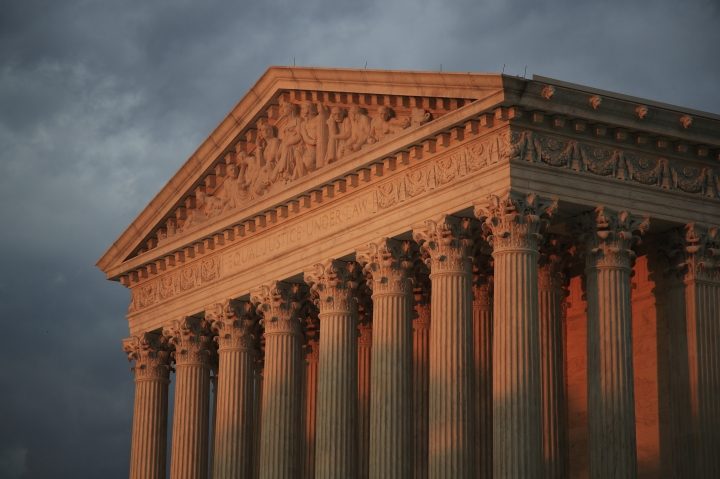 FILE - In this Oct. 4, 2018 file photo, the U.S. Supreme Court is seen at sunset in Washington. The Supreme Court will decide whether the main federal civil rights law that prohibits employment discrimination applies to LGBT people. The justices say Monday they will hear cases involving people who claim they were fired because of their sexual orientation. (AP Photo/Manuel Balce Ceneta)