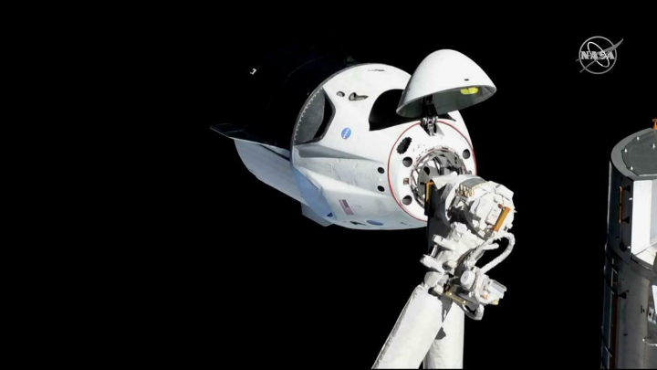 """In this Sunday, March 3, 2019 file photo provided by NASA, the SpaceX Crew Dragon is pictured about 20 meters (66 feet) away from the International Space Station's Harmony module. Officials say SpaceX's new capsule for astronauts suffered an """"anomaly"""" during a routine engine test firing in Florida, causing smoke to be seen for miles. Forty-fifth Space Wing Spokesman Jim Williams tells Florida Today that the anomaly happened Saturday, April 20, 2019 at Cape Canaveral Air Force Station while the SpaceX Crew Dragon capsule was undergoing a """"static test fire."""" (NASA via AP, File)"""