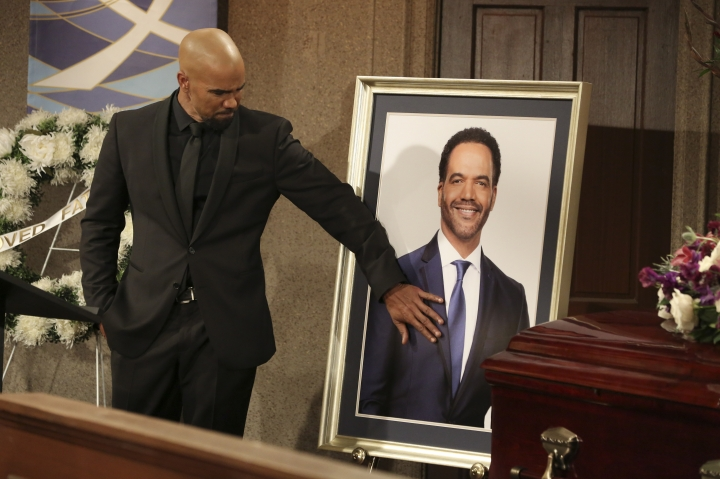 """CORRECTS CHARACTER NAME FROM MORGAN TO WINTERS - This image released by CBS shows Shemar Moore portraying Malcolm Winters during a funeral scene for the character Neil Winters, portrayed by the late actor Kristoff St. John, in the daytime series """"The Young and the Restless."""" St. John, who died at age 52 in February of heart disease, helped cement the prominence of major African-American characters in the traditionally white soap opera world. (Michael Yarish/CBS via AP)"""