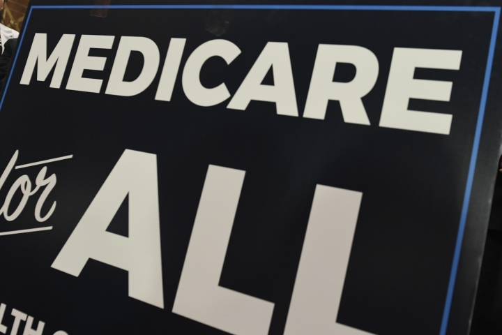 """FILE - In this April 10, 2019 file photo, a sign is shown during a news conference to reintroduce """"Medicare for All"""" legislation, on Capitol Hill in Washington. The financial condition of the government's bedrock retirement programs for middle- and working-class Americans remain shaky, with Medicare pointed toward insolvency by 2026. That's the word from the latest report by the government's overseers of Medicare and Social Security, which paints a sobering picture of the programs, though it's relatively unchanged from last year's update. Social Security would become insolvent in 2035, one year later than previously estimated. (AP Photo/Susan Walsh)"""