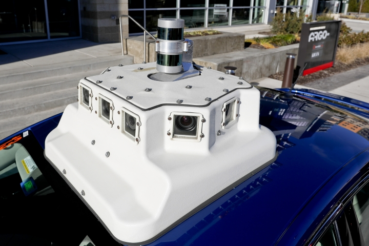 In this Dec. 18, 2018, photo, a sensor and camera array on top of one of the test vehicles from Argo AI, Ford's autonomous vehicle unit, is parked at the company offices in Pittsburgh. In the world of autonomous vehicles, Pittsburgh, Phoenix and Silicon Valley are bustling hubs of development and testing. But ask those involved in self-driving vehicles when we might actually see them carrying passengers in every city, and you'll get an almost universal answer: Not anytime soon. An optimistic assessment is 10 years. Many others say decades as researchers try to conquer a number of obstacles. (AP Photo/Keith Srakocic)