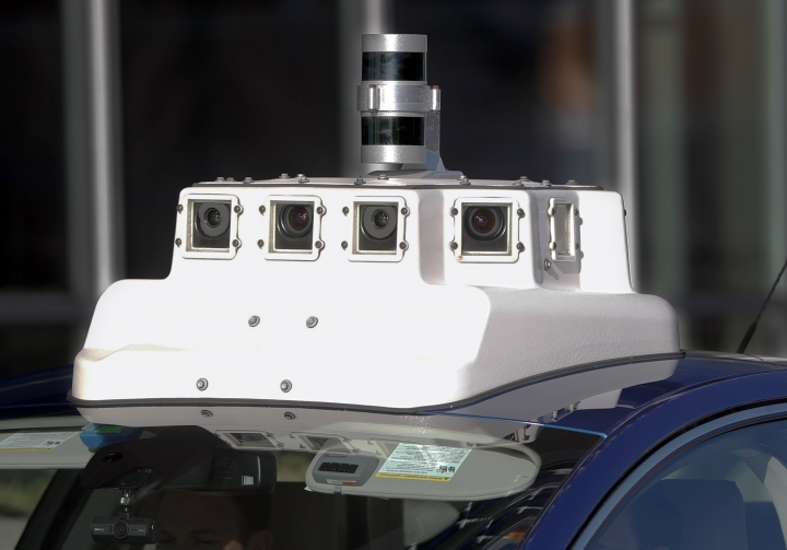 In this Dec. 18, 2018, photo, a sensor and camera array on top of one of the test vehicles from Argo AI, Ford's autonomous vehicle unit, is parked at the company offices in Pittsburgh. The people developing self-driving vehicles say it could be anywhere from 10 years to decades before the cars will be carrying passengers in every city. Researchers are trying to conquer a number of obstacles. (AP Photo/Keith Srakocic)