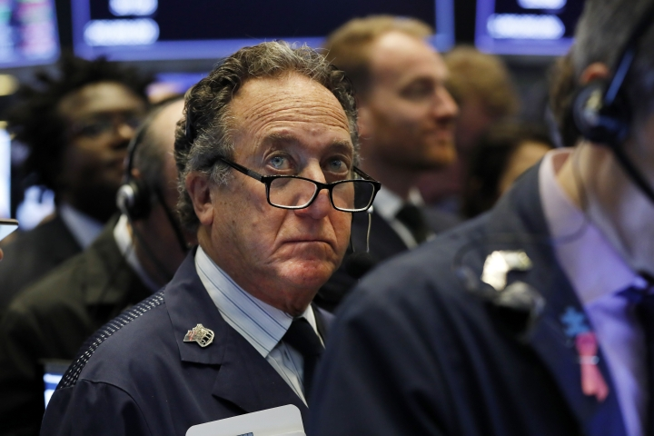 FILE - In this April 12, 2019, file photo trader Steven Kaplan works on the floor of the New York Stock Exchange. The U.S. stock market opens at 9:30 a.m. EDT on Monday, April 22. (AP Photo/Richard Drew, File)