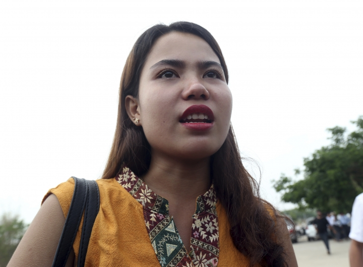 Chit Su Win, wife of Reuters journalist Kyaw Soe Oo, talks to journalists as she leaves the Supreme Court in Naypyitaw, Myanmar, Tuesday, April 23, 2019. Myanmar's Supreme Court on Tuesday rejected the final appeal of two Reuters journalists and upheld seven-year prison sentences for their reporting on the military's brutal crackdown on Rohingya Muslims. (AP Photo/Aung Shine Oo)