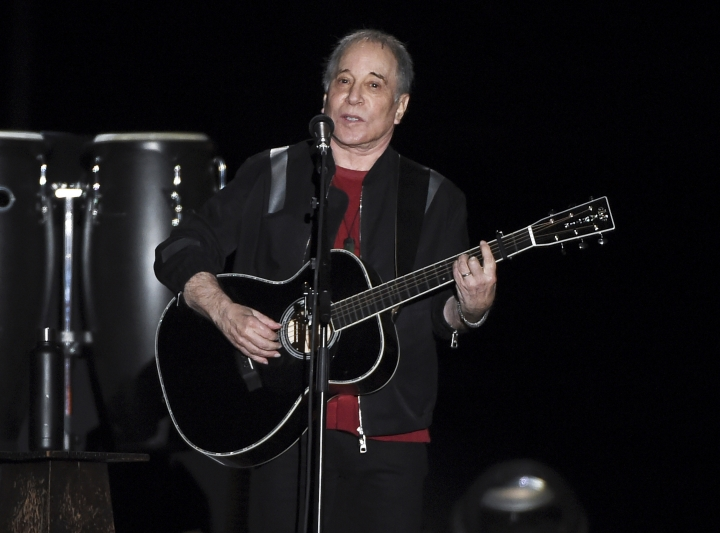 FILE - This Sept. 22, 2018 file photo shows singer-songwriter Paul Simon performing in Flushing Meadows Corona Park during the final stop of his Homeward Bound - The Farewell Tour in New York. Simon is donating all net proceeds from his 2019 Outside Lands Festival performance to two environmental organizations. The icon announced Tuesday that his Aug. 11 performance will benefit the San Francisco Parks Alliance and Friends of the Urban Forest. The Outside Lands Festival will take place Aug. 9-11 at San Francisco's Golden Gate Park. (Photo by Evan Agostini/Invision/AP, File)