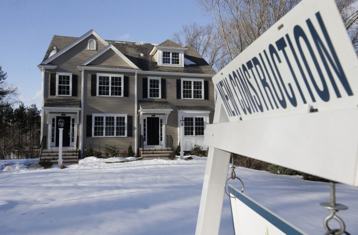 FILE - In this Feb. 21, 2019, file photo a sign is posted near a newly constructed home in Natick, Mass. On Tuesday, April 23, the Commerce Department reports on sales of new homes in March. (AP Photo/Steven Senne, File)