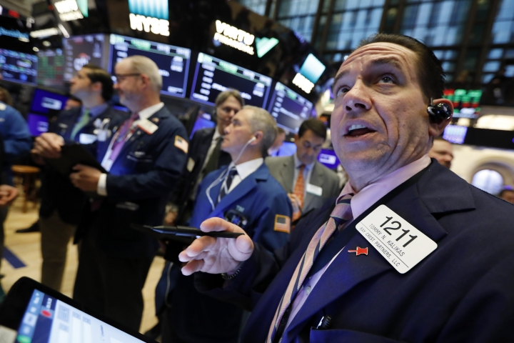 FILE - In this Thursday, April 18, 2019, file photo, Tommy Kalikas, right, works with fellow traders on the floor of the New York Stock Exchange during the Brigham Minerals IPO. Stock investors had to go on a harrowing round trip over the last seven months, but the market may be in a healthier place after it. The S&P 500 index of big U.S. stocks is back to a record high, closing above 2,930 on Tuesday for the first time since Sept. 20. (AP Photo/Richard Drew, File)