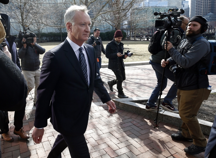 FILE - In this April 3, 2019 file photo, TobyMacFarlane departs federal court in Boston after facing charges in a nationwide college admissions bribery scandal. Authorities said Tuesday, April 23, that MacFarlane, a former senior executive at a title insurance company, will plead guilty to racketeering conspiracy and cooperate with federal authorities in the case. (AP Photos/Michael Dwyer, File)