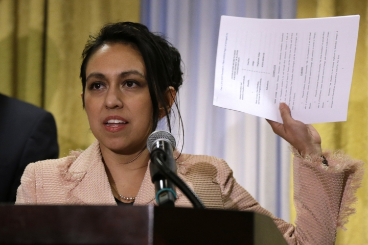 """Gloria Schmidt, a lawyer for Olabinjo Osundairo and Abimbola Osundairo, who said they helped Jussie Smollett stage a racist and homophobic attack against himself, speaks during a news conference Tuesday, April 23, 2019, in Chicago. The brothers are suing the """"Empire"""" actor's attorneys for defamation. The federal lawsuit names Mark Geragos and his law firm as defendants and that they continued to say publicly that the brothers """"led a criminally homophobic, racist and violent attack against Mr. Smollett,"""" even though they knew it wasn't true. (AP Photo/Kiichiro Sato)"""