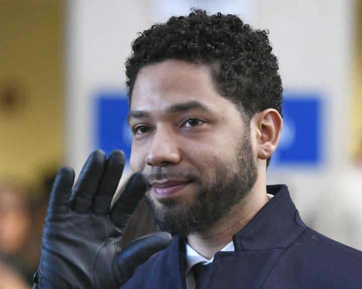 "FILE - In this March 26, 2019, file photo, actor Jussie Smollett smiles and waves to supporters before leaving Cook County Court after his charges were dropped in Chicago. Two brothers, Olabinjo Osundairo and Abimbola Osundairo, who said they helped Smollett stage a racist and homophobic attack against himself are suing the ""Empire"" actor's attorneys for defamation. A lawyer for the brothers filed the federal lawsuit Tuesday, April 23, in Chicago. (AP Photo/Paul Beaty, File)"