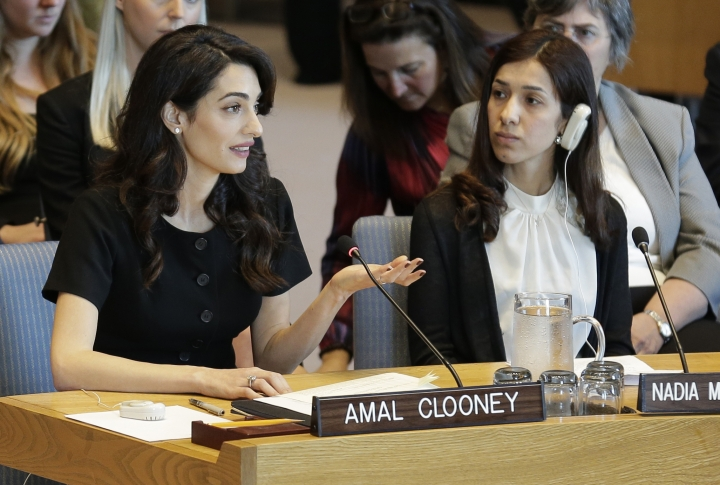 While Nadia Murad Basee Taha, right, listens, Amal Clooney speaks during a Security Council meeting on sexual violence at United Nations headquarters, Tuesday, April 23, 2019. (AP Photo/Seth Wenig)