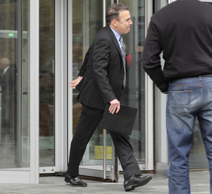 Jeff Zirkle, center, one of the owners of electronics recycler Total Reclaim Inc., which is based in the Seattle suburb of Kent, Wash., leaves a federal courthouse, Tuesday, April 23, 2019, in Seattle. Zirkle and co-owner Craig Lorch were sentenced to 28 months in prison Tuesday for what prosecutors described as the largest known fraud of its type in the nation: a seven-year scheme to ship dangerous waste to Hong Kong, rather than safely handling it in the U.S. as promised. (AP Photo/Ted S. Warren)