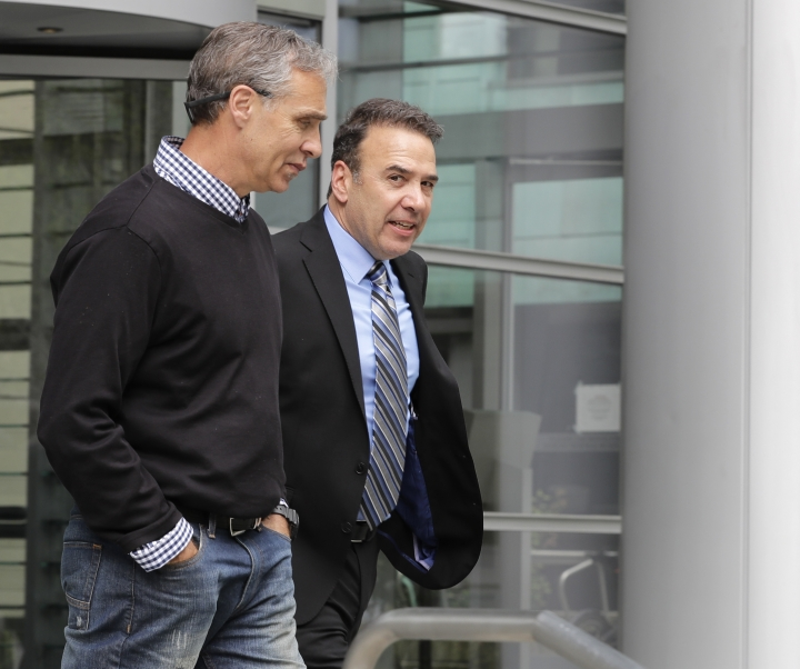 Jeff Zirkle, right, one of the owners of electronics recycler Total Reclaim Inc., which is based in the Seattle suburb of Kent, Wash., leaves a federal courthouse with an unidentified person at left, Tuesday, April 23, 2019, in Seattle. Zirkle and co-owner Craig Lorch (not shown) were sentenced to 28 months in prison Tuesday for what prosecutors described as the largest known fraud of its type in the nation: a seven-year scheme to ship dangerous waste to Hong Kong, rather than safely handling it in the U.S. as promised. (AP Photo/Ted S. Warren)