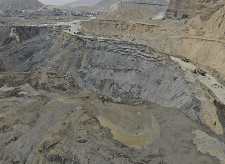 A view overlooking the scene of a mudslide at a jade gemstone mining site looking down where the mudslide swept away workers and covered mining equipment, including bulldozers and backhoes, Tuesday, April 23, 2019, in Hpakant area of Kachin state, northern Myanmar. A lawmaker representing the area, Tin Soe, said that more than 50 people are believed to have died in the mudslide which happened on Monday night. (Zaw Moe Htet via AP)