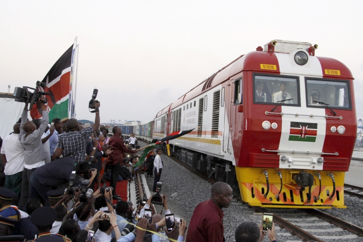 FILE - In this May 30, 2017, file photo, the SGR cargo train rides from the port containers depot on a Chinese-backed railway costing nearly $3.3 billion, opened by Kenya's president as one of the country's largest infrastructure project since independence, in Mombasa, Kenya. The eventually will link a large part of East Africa to a major port on the Indian Ocean as China seeks to increase trade and influence. Asian and African leaders plan to press Beijing at a conference starting Thursday, April 24, 2019, to reduce the politically volatile debt burden left by its Belt and Road Initiative to build ports and other trade-related infrastructure. (AP Photo/Khalil Senosi, File)