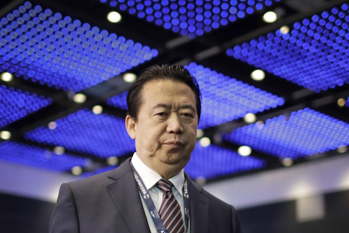 FILE - In this July 4, 2017, file photo, Interpol President, Meng Hongwei, walks toward the stage to deliver his opening address at the Interpol World Congress in Singapore. China has formally arrested Meng on suspicion of accepting bribes. The Supreme People's Procuratorate announced the indictment on Wednesday. (AP Photo/Wong Maye-E, File)