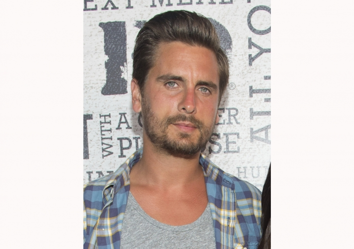 "FILE - This Aug. 9, 2014 file photo shows Scott Disick at the ""Party Under The Stars"" benefit in New York. Disick, a frequent face on ""Keeping Up With the Kardashians,"" has been greenlighted to star in ""Flip It like Disick,"" which will follow him on his adventures remodeling and selling celebrity real estate. (Photo by Scott Roth/Invision/AP, File)"