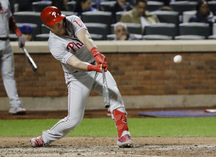 Philadelphia Phillies' Rhys Hoskins hits a triple during the eighth inning of a baseball game against the New York Mets, Wednesday, April 24, 2019, in New York. (AP Photo/Frank Franklin II)