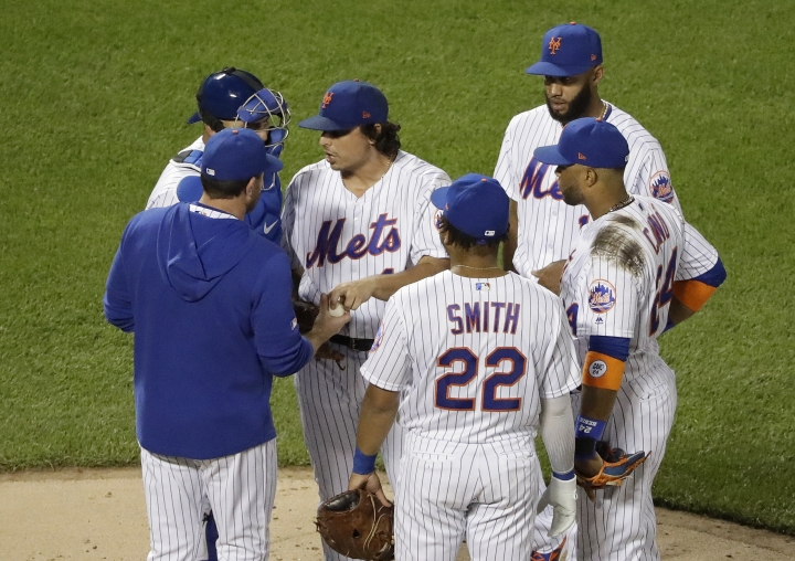 New York Mets starting pitcher Jason Vargas hands the ball to manager Mickey Callaway, left, as he leave the game during the fifth inning of a baseball game Wednesday, April 24, 2019, in New York. (AP Photo/Frank Franklin II)