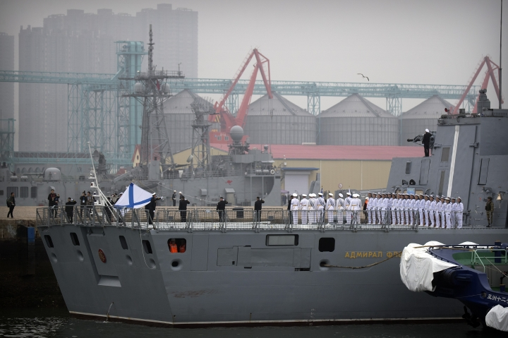 In this April 21, 2019, photo, Russian sailors stand on the deck of the Russian frigate Admiral Gorshkov as it docks at a port in Qingdao in eastern China's Shandong Province. Chinese Defense Ministry spokesman Ren Guoqiang said Thursday, April 25, 2019, that naval drills between China and Russia will be held off the eastern port city of Qingdao next week. (AP Photo/Mark Schiefelbein)