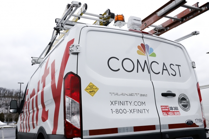 FILE - This Jan. 24, 2019, file photo shows a Comcast truck in Pittsburgh. Comcast Corp. reports earns on Thursday, April 25. (AP Photo/Gene J. Puskar, File)