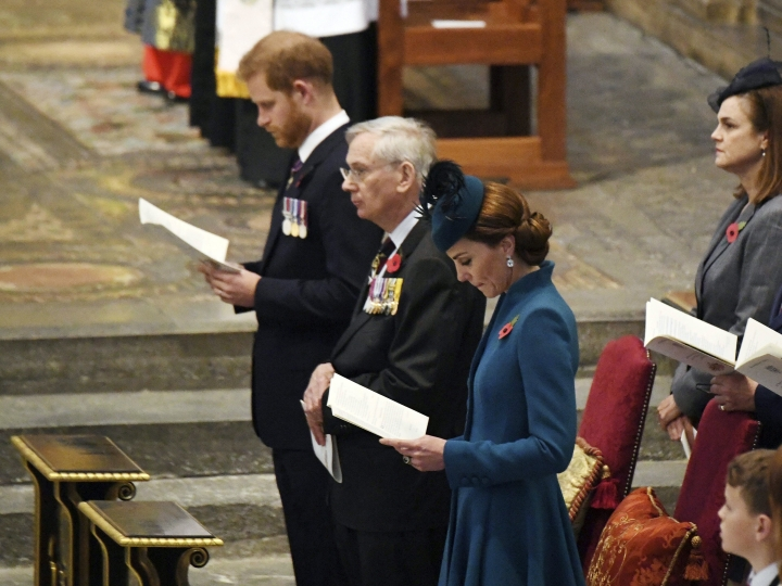 Kate, the Duchess of Cambridge, centre, Prince Harry, the Duke of Sussex background centre and the Duke of Gloucester attend the Anzac Day Service of Commemoration and Thanksgiving at Westminster Abbey, in London, Thursday April 25, 2019. Anzac Day has been commemorated in London since the first anniversary of the Anzac landings at Gallipoli in 1916, when King George V attended a service at Westminster Abbey and more than 2,000 Australian and New Zealand troops marched through the streets. (Victoria Jones/Pool Photo via AP)