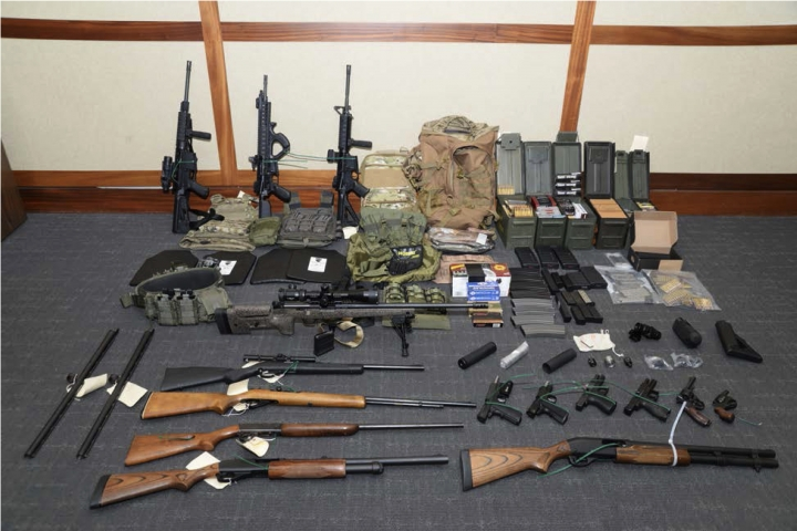 FILE - This undated file image provided by the U.S. District Court in Maryland shows a photo of firearms and ammunition that was in the motion for detention pending trial in the case against Christopher Hasson. A federal magistrate agreed on Thursday, April 25, 2019, to order the pretrial release of the Coast Guard lieutenant accused of creating a hit list of prominent Democrats, Supreme Court justices, network TV journalists and social media company executives. (U.S. District Court via AP, File)