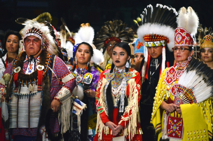 FILE - In this April 28, 2017, file photo, Native American dancers from the United States and Canada take part in the grand entry to the Gathering of Nations in Albuquerque, N.M. Friday, April 26, 2019 marks the beginning of a two-day powwow in New Mexico that represents one of the largest annual gatherings of indigenous people in the United States. Organizers say they want to build awareness this year around the deaths and disappearances of Native American women. (AP Photo/Russell Contreras, File)
