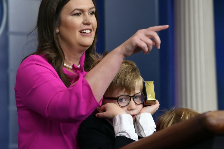 White House press secretary Sarah Sanders, standing next to her son Huck Sanders, calls on a child during a briefing at the White House in Washington, Thursday, April 25, 2019. Children of journalists and White House staff were invited to attend the briefing and ask Sanders questions. (AP Photo/Susan Walsh)