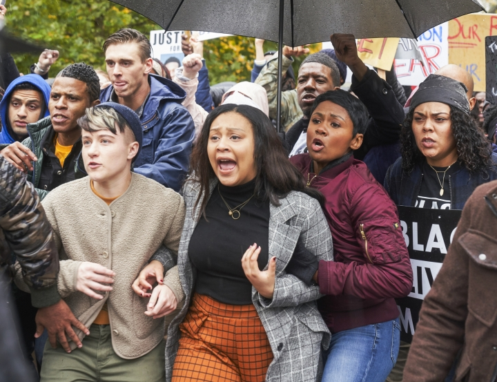 "This image released by CBS shows Aliyah Royale as Jira Calder-Brennan, center, in a scene from the limited series ""The Red Line,"" which debuts April 28 on CBS. (Parrish Lewis/CBS via AP)"