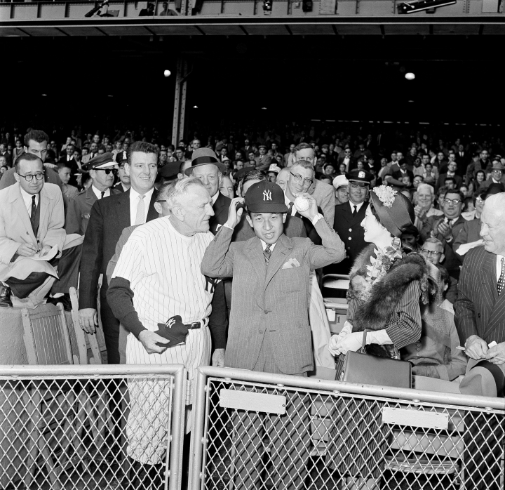Japan's Crown Prince Akihito tries on a New York Yankees cap at Yankee Stadium in the Bronx borough of New York, Oct. 2, 1960, where he saw the American League pennant winners play the Boston Red Sox in the last game of the season. Crown Princess Michiko and Yankee manager Casey Stengel watch the prince who is holding a baseball autographed by members of the Yankees. When he abdicates April 30, 2019, Akihito will become the first emperor in Japan's modern history to see his era end without ever having a war. (AP Photo)