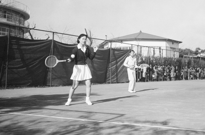 In this Dec. 6, 1958, photo, Michiko Shoda takes the shot as she and her fiance, Crown Prince Akihito, team up for a mixed doubles tennis match at the Tokyo Lawn Tennis club. It was the first time the pair had been photographed together since their engagement was announced November 27. Miss Shoda will become Japan's first commoner queen in more than 2,000 years when Akihito assumes the thrown. When he abdicates April 30, 2019, Akihito will become the first emperor in Japan's modern history to see his era end without ever having a war. (AP Photo)