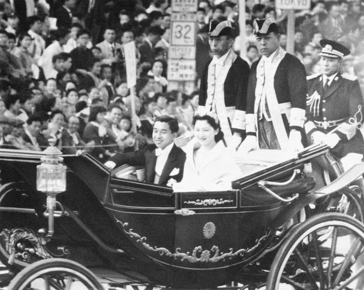 Japan's Prince Akihito and his bride, the former Michiko Shoda, acknowledge the cheers of Tokyo throngs as the royal carriage rolls through the city after their wedding, April 10, 1959. When he abdicates April 30, 2019, Akihito will become the first emperor in Japan's modern history to see his era end without ever having a war. (AP Photo)