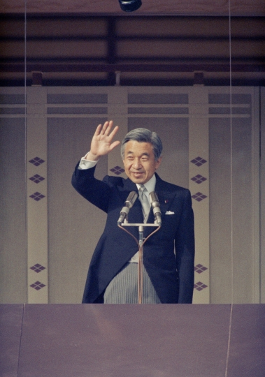 In this Dec. 23, 1992, photo, Japan's Emperor Akihito waves to well-wishers from the Imperial Palace balcony in Tokyo as he makes a public appearance celebrating his 59th birthday. When he abdicates April 30, 2019, Akihito will become the first emperor in Japan's modern history to see his era end without ever having a war. (AP Photo/Shizuo Kambayashi)
