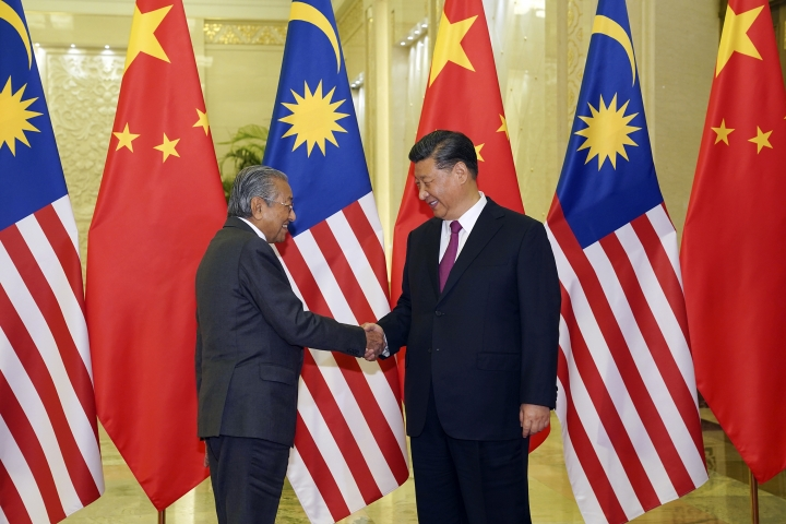 Chinese Premier Xi Jinping, right, shakes hands with Malaysian Prime Minister Mahathir Mohamad before a bilateral meeting of the Second Belt and Road Forum at the Great Hall of the People on Thursday, April 25, 2019 in Beijing, China. (Andrea Verdelli/Pool Photo via AP)