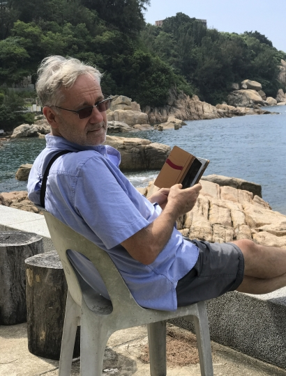 Award-winning Hong Kong-based photographer Michael Wolf is photographed in Cheung Chau, Hong Kong in 2016. Hong Kong art gallery director Sarah Greene said that Wolf, known for his work depicting mega-cities, has died Tuesday night at his home. She said he was 64. Wolf won first prize in the World Press Photo competition in 2005 and 2010. (Blue Lotus Gallery via AP)
