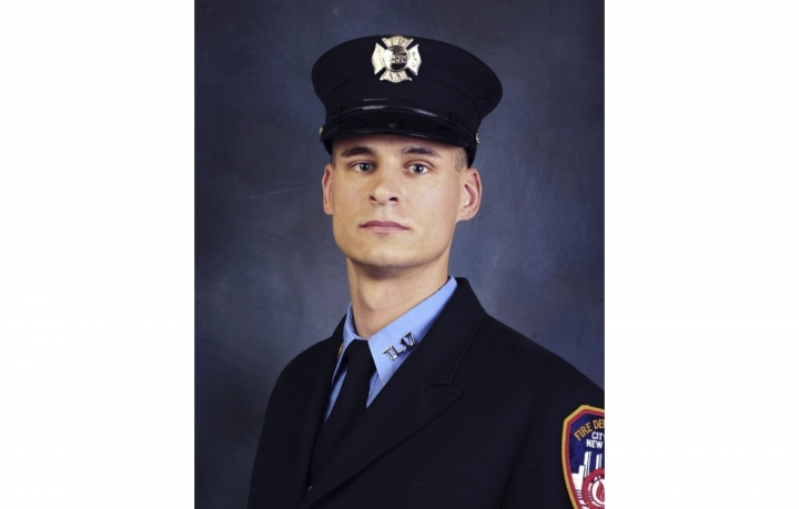 FILE - This undated, file photo provided on April 9, 2019, by the Fire Department of New York shows firefighter Christopher Slutman. The 15-year member of the Fire Department was among three American service members killed by a roadside bomb in Afghanistan on Monday, April 8. (Fire Department of New York via AP, File)