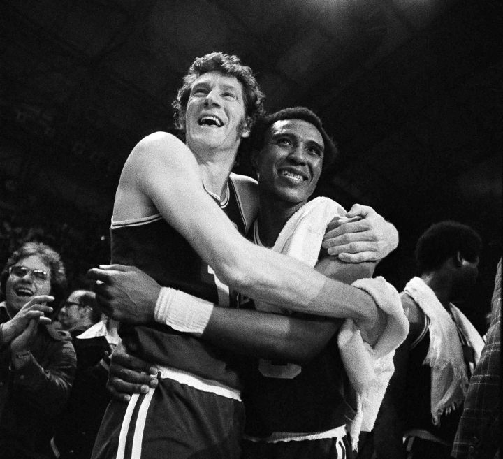 FILE - In this May 13, 1974, file photo, Boston Celtics' John Havlicek, left, and Jo-Jo White celebrate defeating the Milwaukee Bucks, 102-87 to win the NBA Championship, in Milwaukee, Wisc. The Celtics said Havlicek died Thursday, April 25, 2019, in Jupiter, Florida. He was 79. The cause of death wasn't immediately available. (AP Photo/File)
