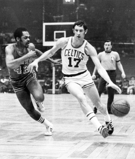 FILE - In this Jan. 8, 1970 file photo, Boston Celtics' John Havlicek (17) protects the ball with his body from Atlanta Hawks' Walt Hazzard (42) during an NBA basketball game in Boston. The Boston Celtics say Hall of Famer John Havlicek, whose steal of Hal Green's inbounds pass in the final seconds of the 1965 Eastern Conference finals against the Philadelphia 76ers remains one of the most famous plays in NBA history, has died. The team says Havlicek died Thursday, April 25, 2019 at age 79. (AP Photo/File)