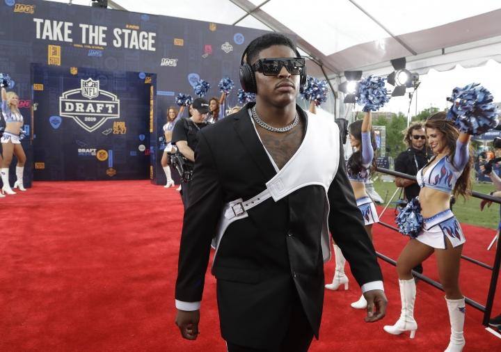Michigan linebacker Devin Bush walks the red carpet ahead of the first round at the NFL football draft, Thursday, April 25, 2019, in Nashville, Tenn. (AP Photo/Steve Helber)