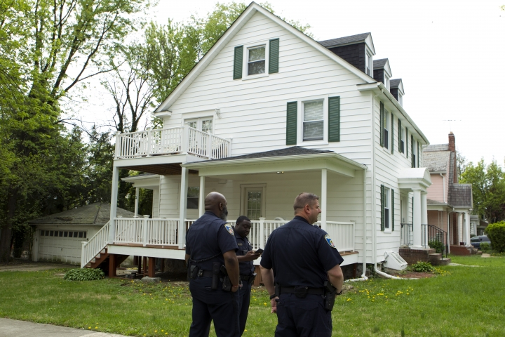 Baltimore police officers stand outside the house of Baltimore Mayor Catherine Pugh in Baltimore, MD., Thursday, April 25, 2019. Agents with the FBI and IRS are gathering evidence inside the two homes of Pugh and also in City Hall. (AP Photo/Jose Luis Magana)
