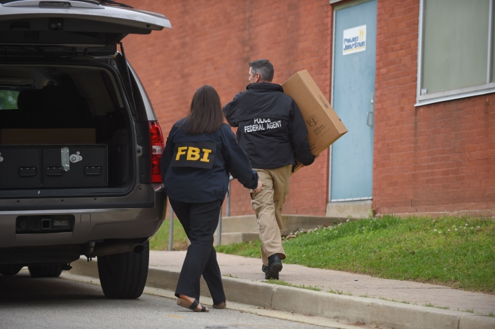 Federal agents arrive at the Maryland Center for Adult Training in Baltimore. MD, Thursday, April 25, 2019. Agents with the FBI and IRS are gathering evidence inside the two homes of Baltimore Mayor Catherine Pugh and in City Hall, as well as the office of her lawyer and the home of a top aide. (Loyd Fox/Baltimore Sun via AP)