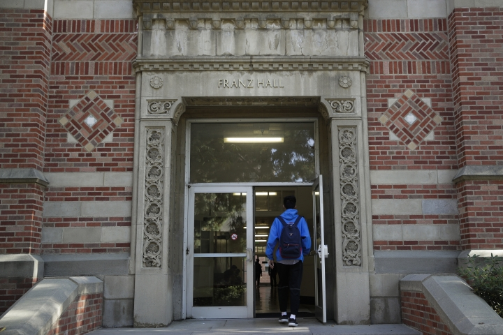 A student enters Franz Hall at University of California, Los Angeles, Thursday, April 25, 2019, in the Westwood section of Los Angeles. Hundreds of students and staff at two Los Angeles universities, including UCLA, have been placed under quarantine because they may have been exposed to measles and either have not been vaccinated or cannot verify that they are immune, officials said Thursday. (AP Photo/Jae C. Hong)